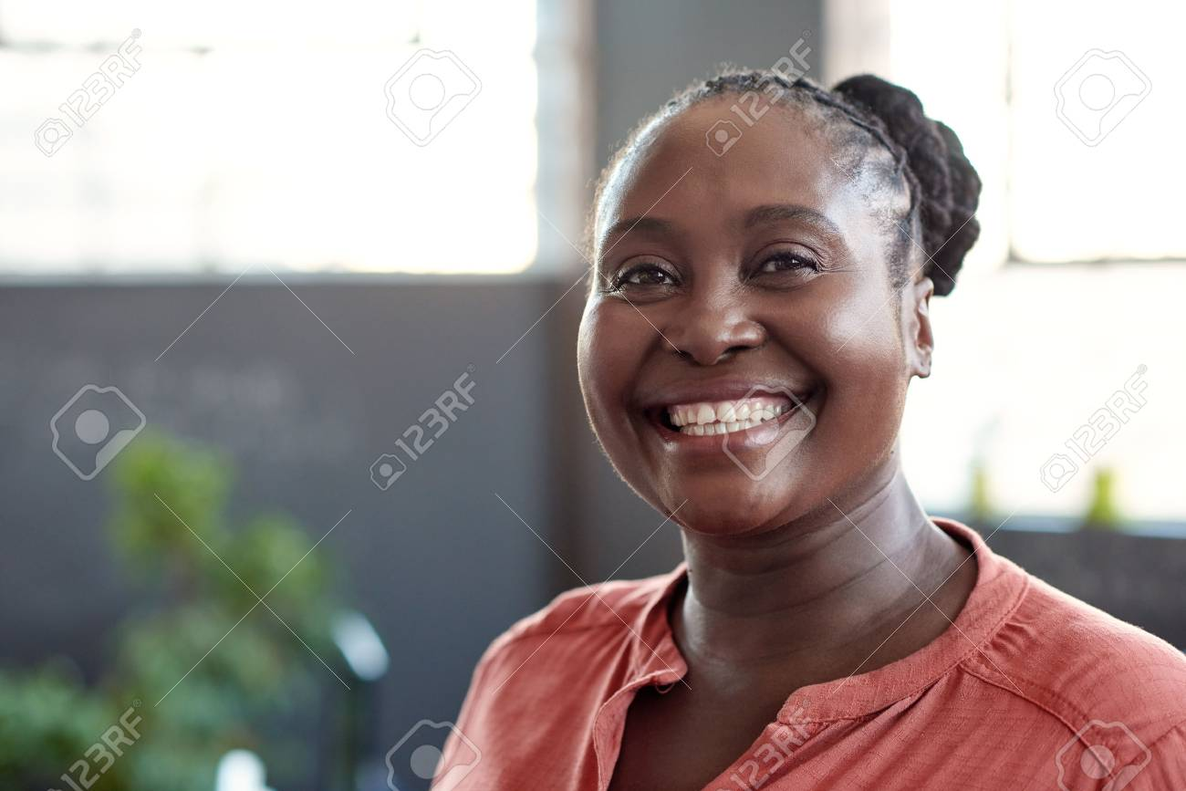 Young African businesswoman smiling confidently in an office - 80738587