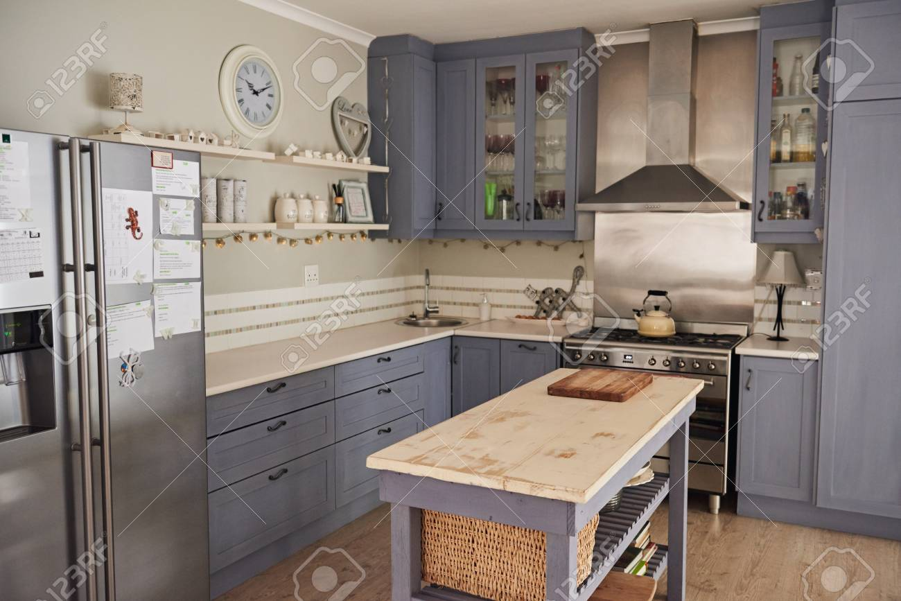 Country style kitchen with with an island in a home