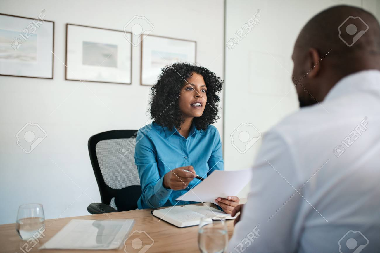 Manager conducting a job interview in her office - 125163537