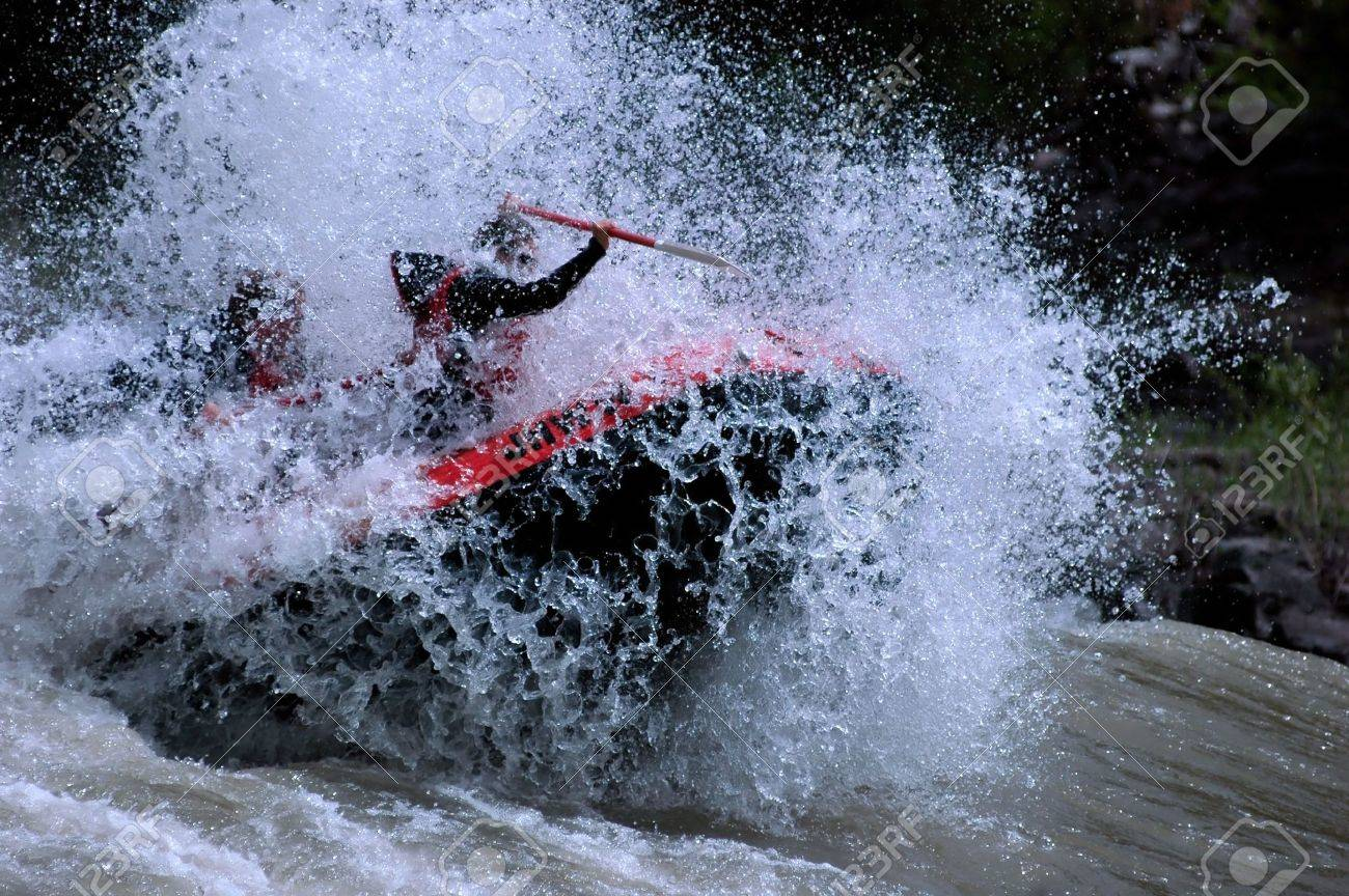 red raft blasting through river wave from front Stock Photo - 428963