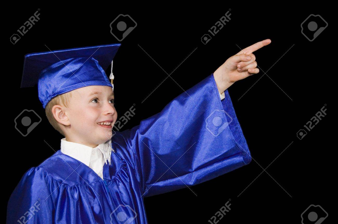 Young Boy In Graduation Cap And Gown Pointing Out Of Frame And ...