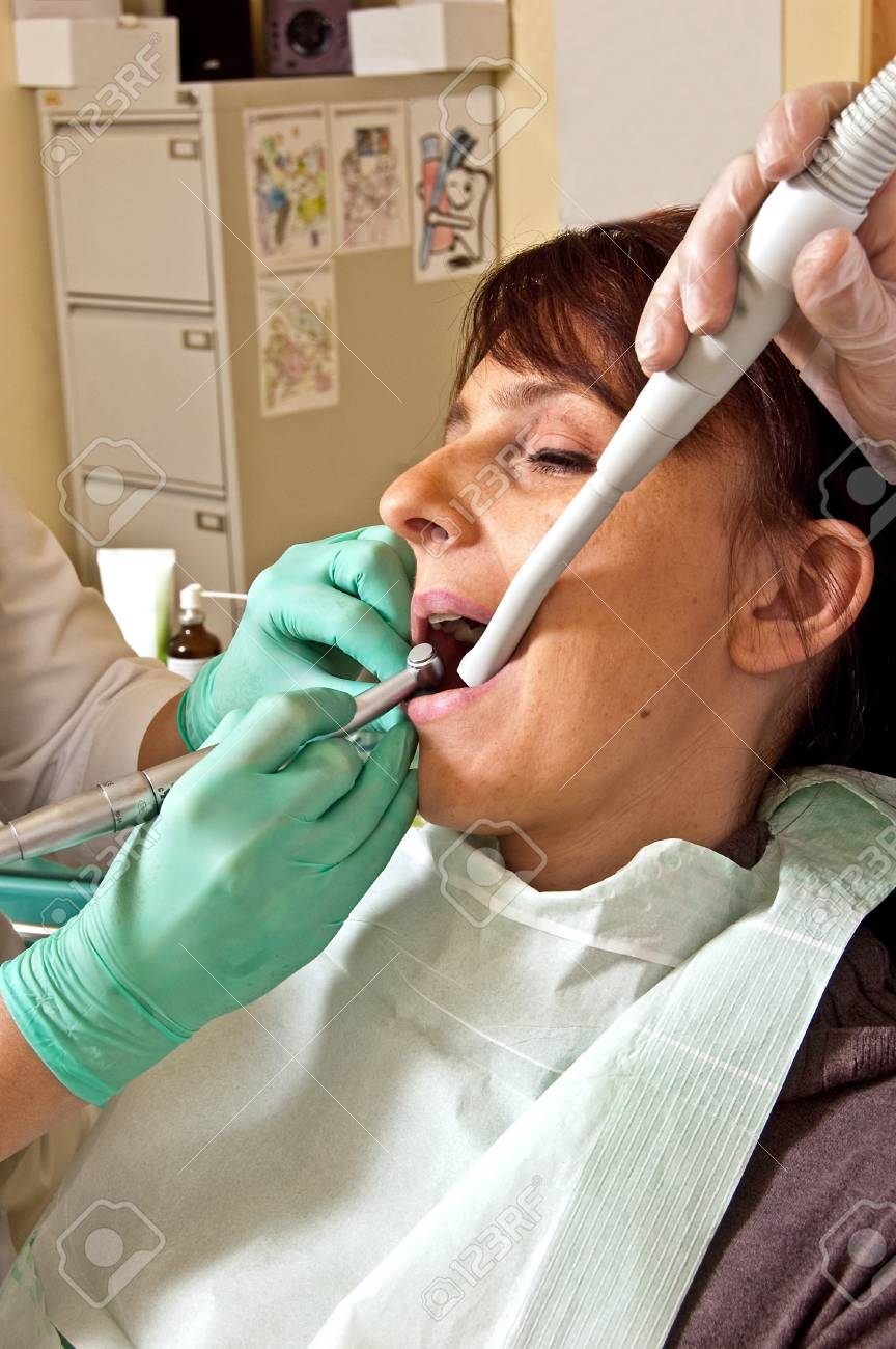 Dental treatment in a young woman in a dentist's office Stock Photo - 16880117