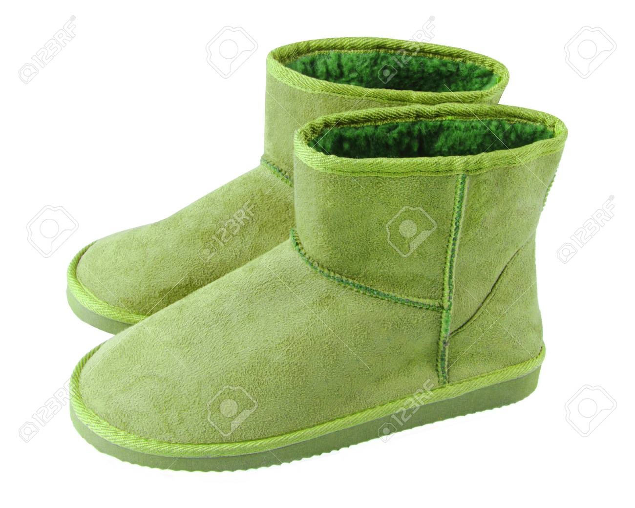 3f35b4efe57 Chartreuse light green pair of short winter ugg boots isolated..