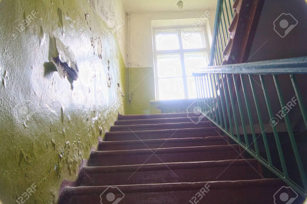ladder on second floor in old school building - 56594635