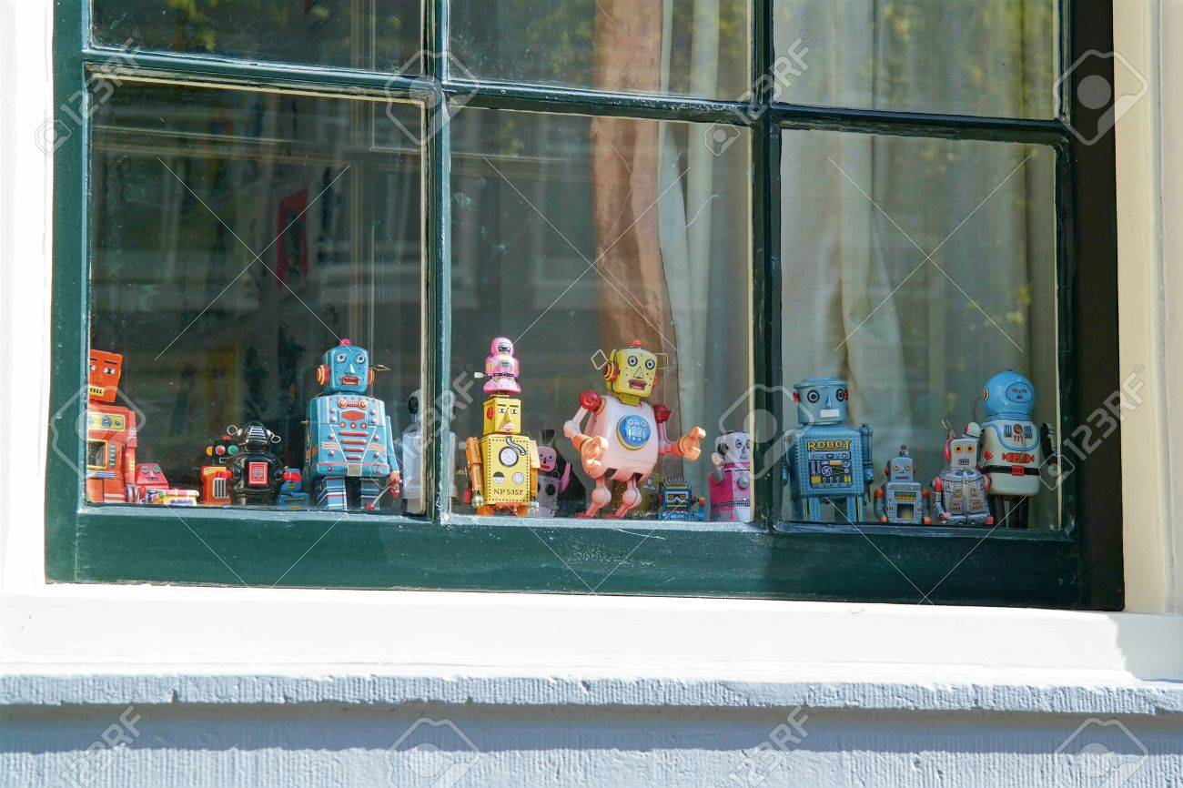 Small toy robots in window - 50744442