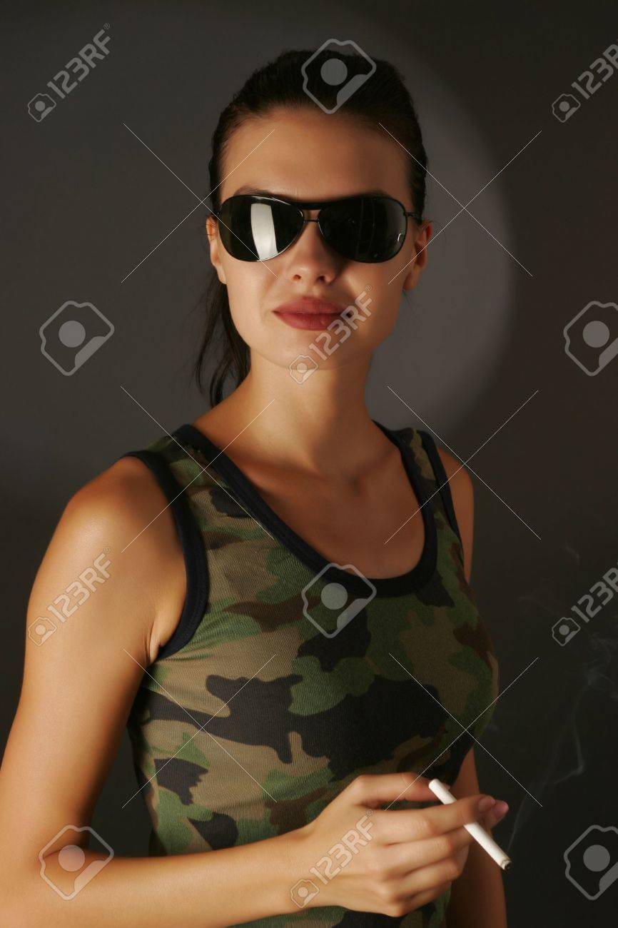 Military girl with cigarette isolated on black background Stock Photo - 3085768