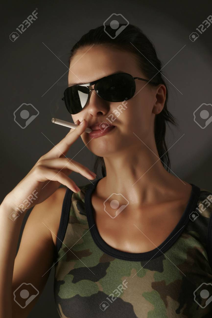 Sensual girl in camouflage with cigarette isolated on black background Stock Photo - 3093667