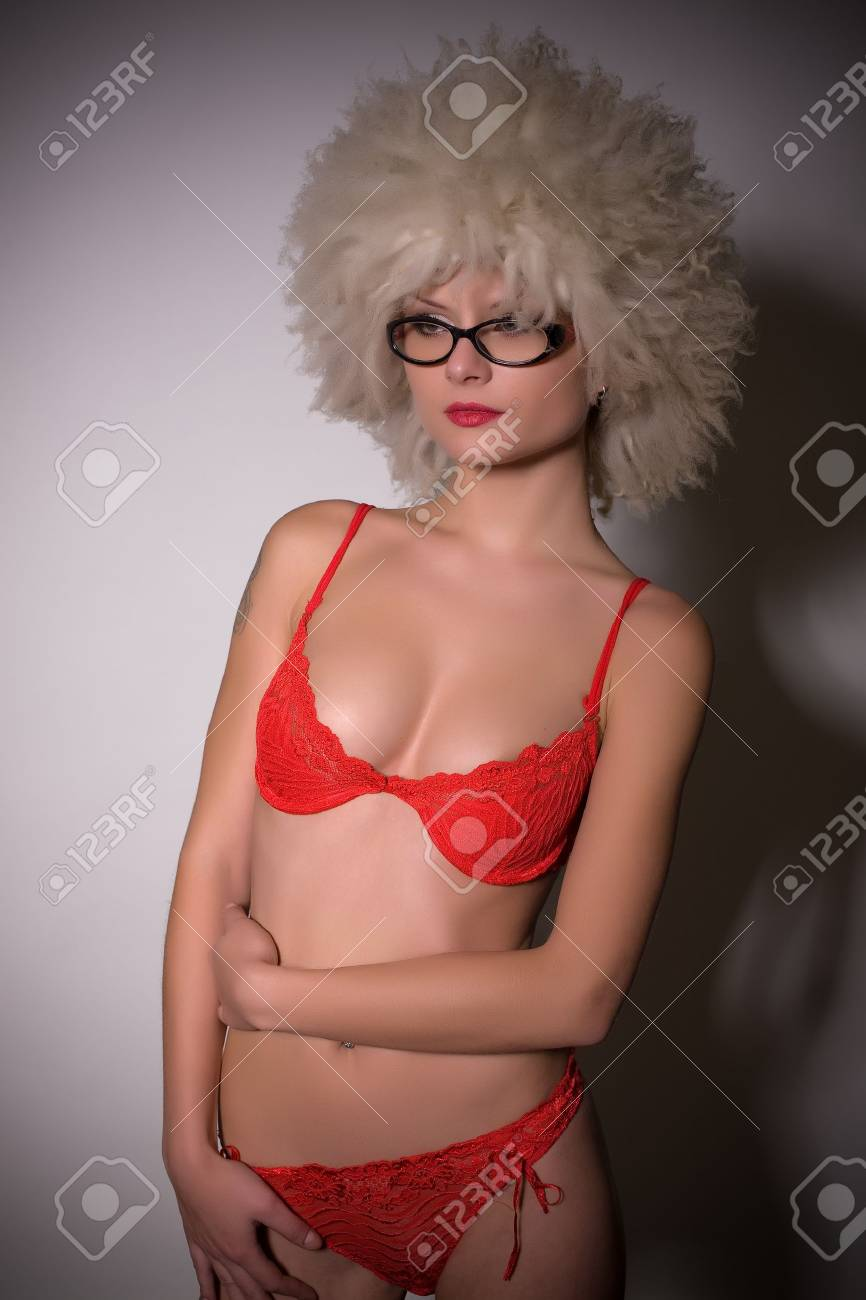 Pretty girl in glasses and furry hat over light background Stock Photo - 4339150