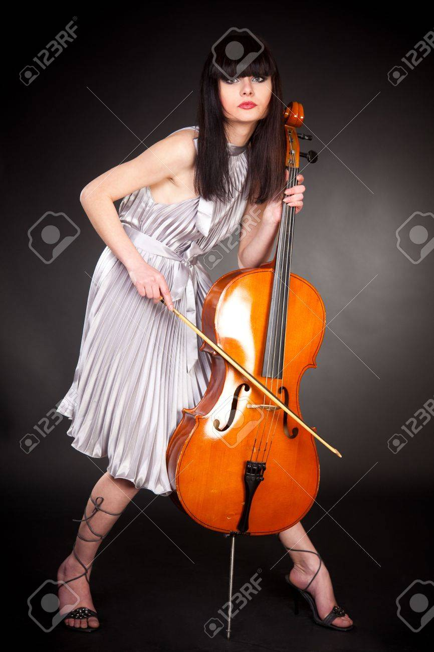 Brunette girl with cello, close up studio isolated shot Stock Photo - 7941864