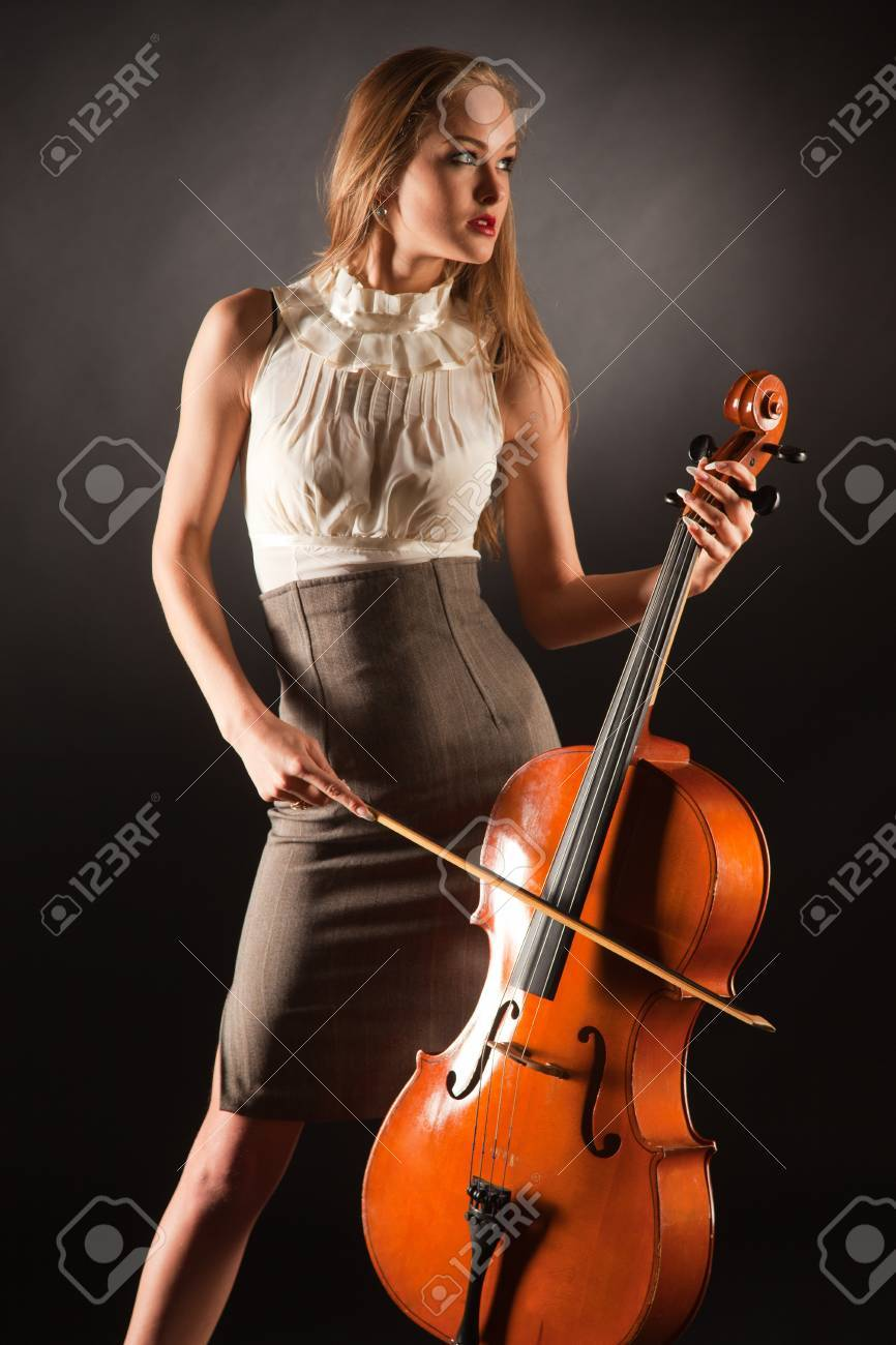 Elegant girl playing on bass-viol, studio isolated shot Stock Photo - 8867657