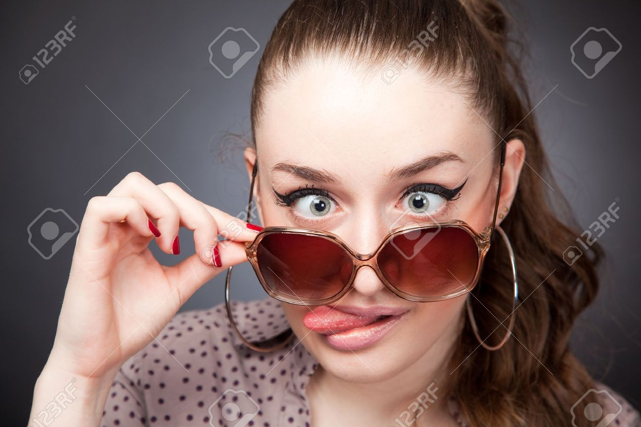 Crazy girl with glasses, portrait studio isolated shot Stock Photo - 9060438