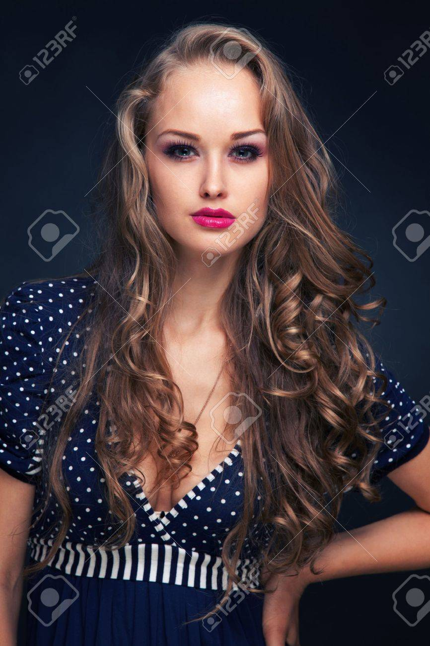 Attractive young girl in blue dress, vertical studio isolated shot Stock Photo - 9122866