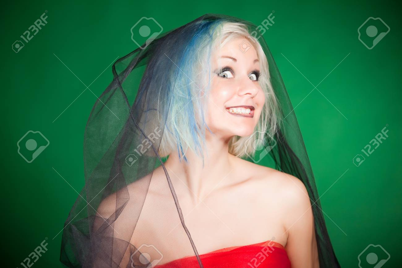 Crazy grimace, close up portrait shot over green background Stock Photo - 9888779