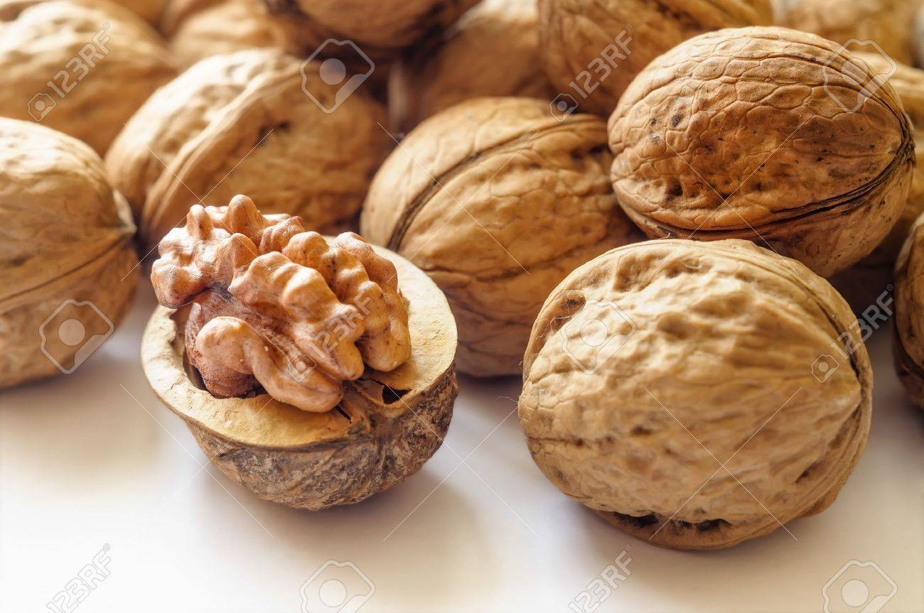 Close up of a heap of dry tasty walnuts - 19020749