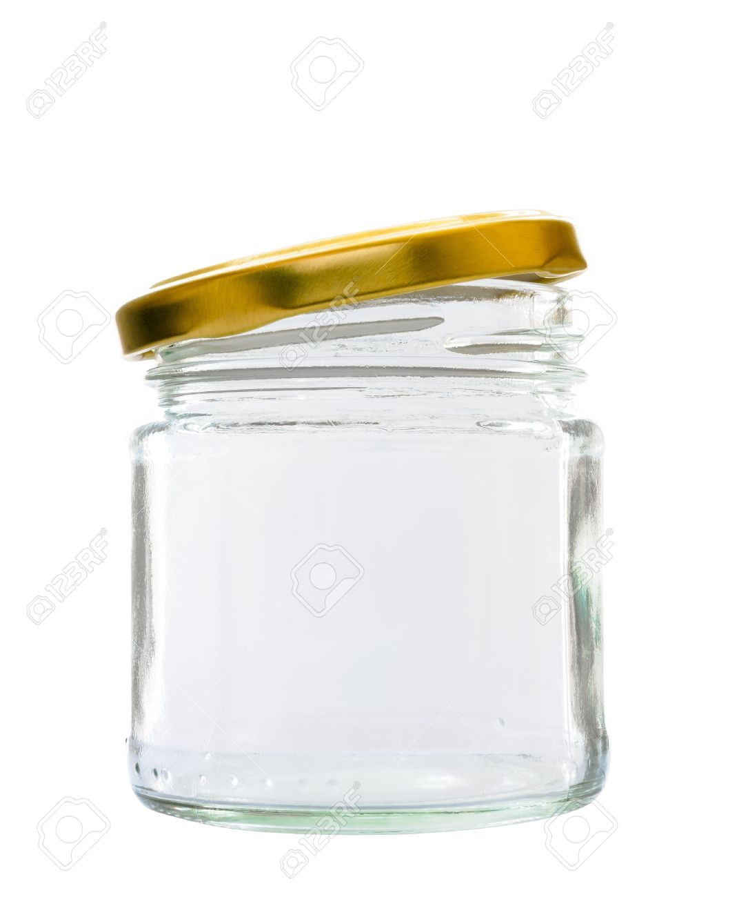 transparent glass jar on white background with the open gold