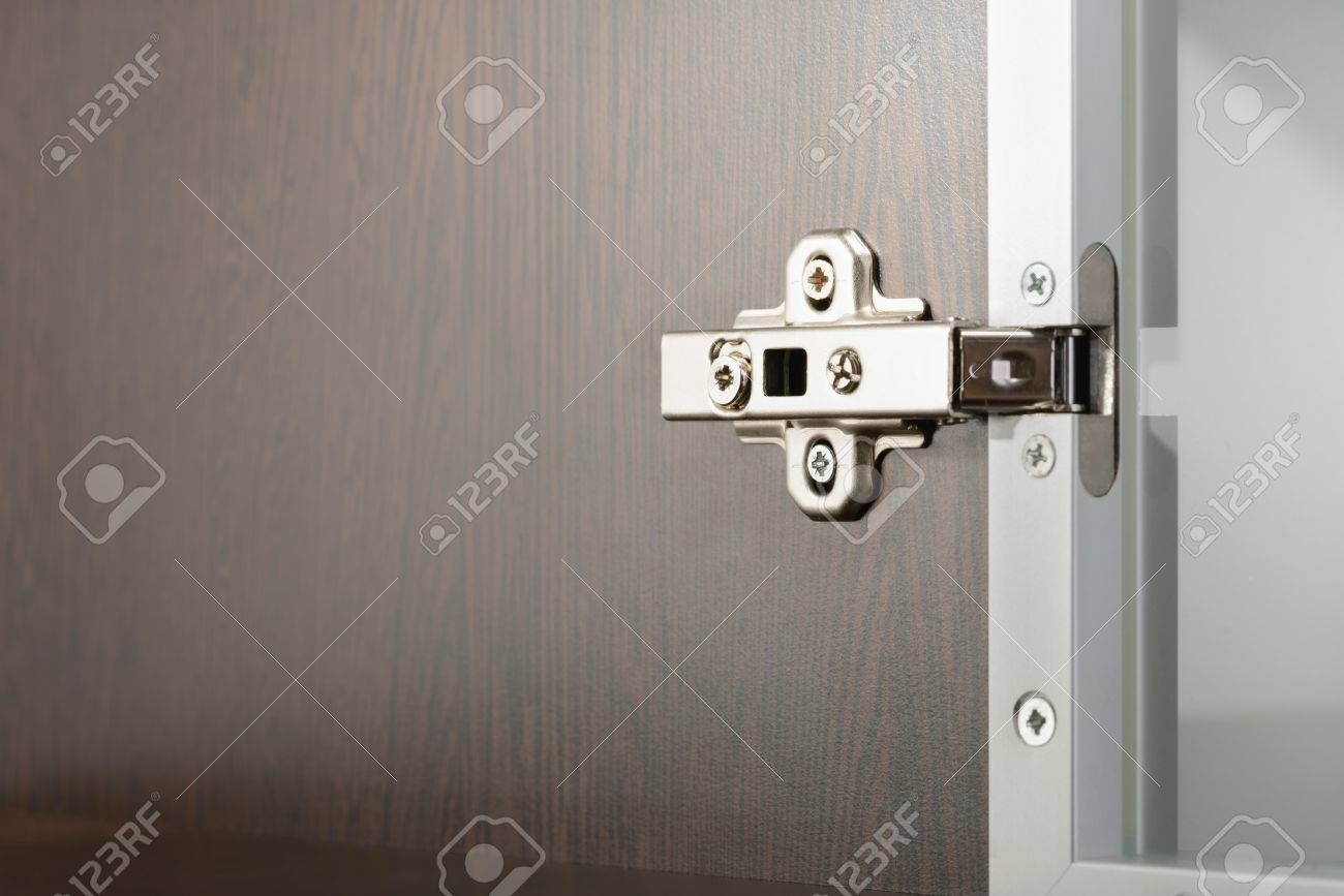 Glass Door Cabinet Hinges Closeup Of An Adjustable Concealed Hinge Fixed On A Cabinet With
