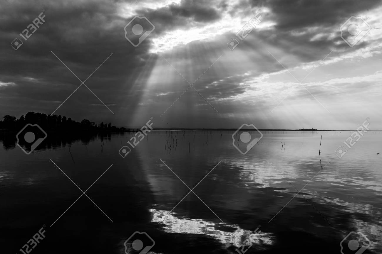 perfectly symmetric and spectacular view of a lake with clouds sky
