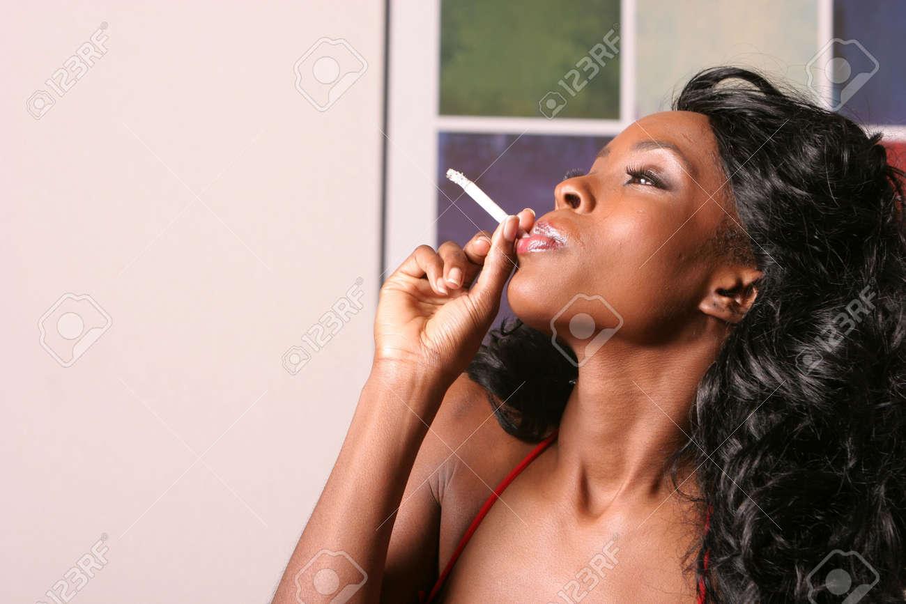 Beautiful sexy black woman smoking a cigarette Stock Photo - 1150137