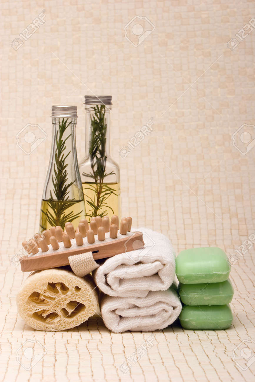 Spa towels, soaps, loofah, massager and essential oils Stock Photo - 1304685