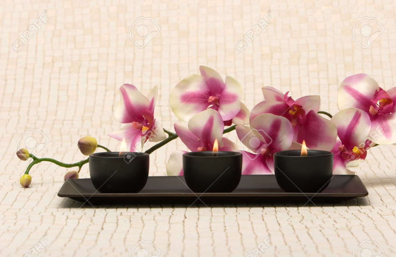 Aromatherapy candles and pink orchid Stock Photo - 1620604