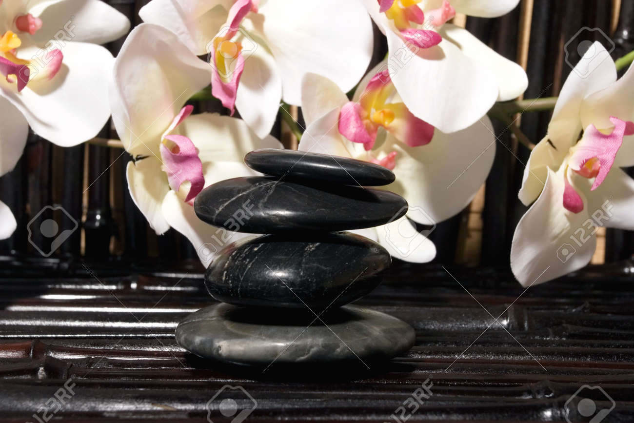 stones and orchid flowers on bamboo Stock Photo - 3171588
