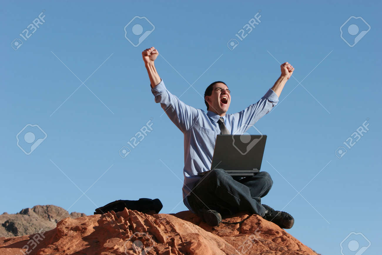 Ecstatic businessman with his laptop Stock Photo - 3365134