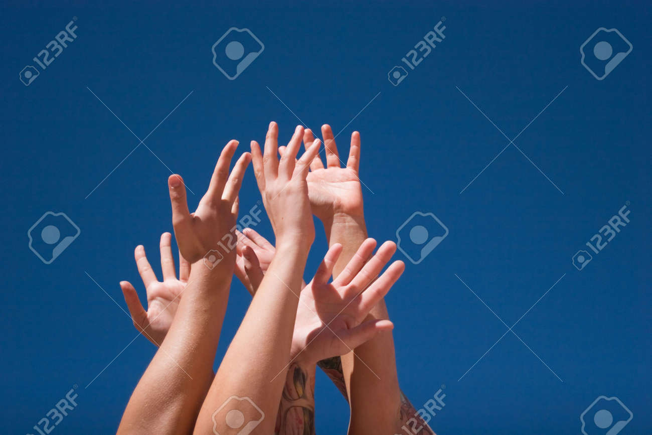Group of people hands in the air Stock Photo - 3406824