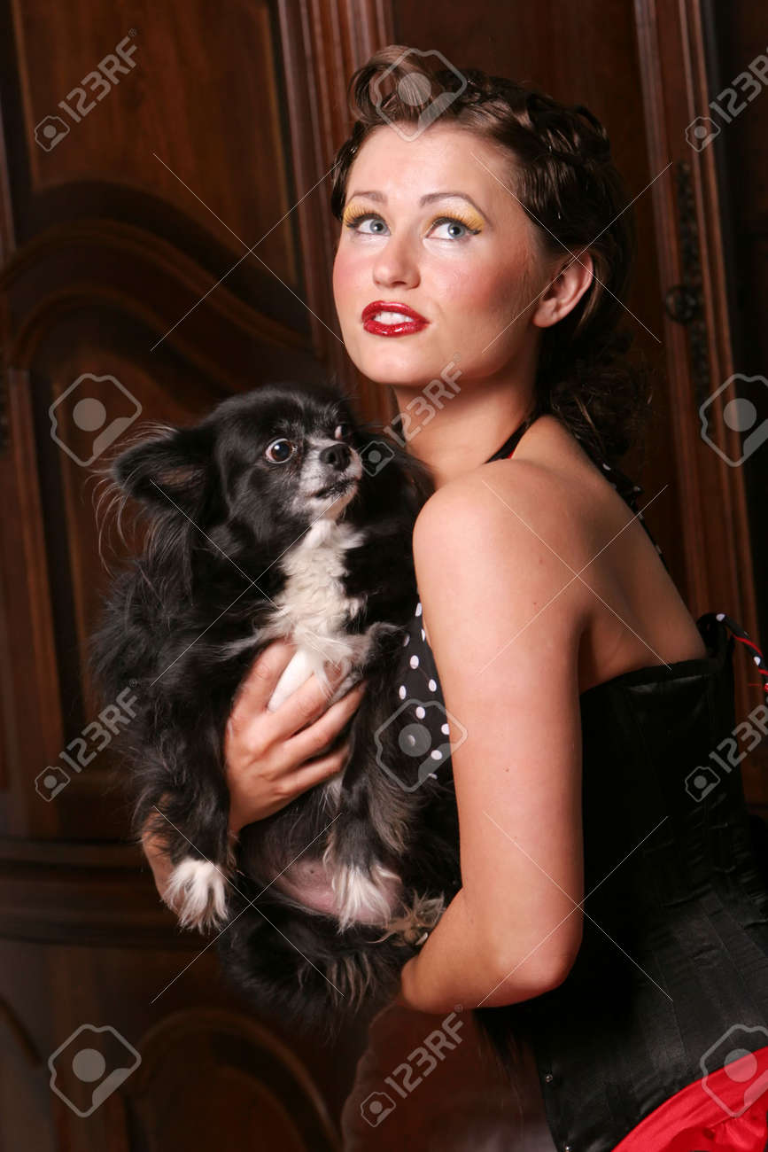 Sexy pinup girl with her puppy Stock Photo - 5284844
