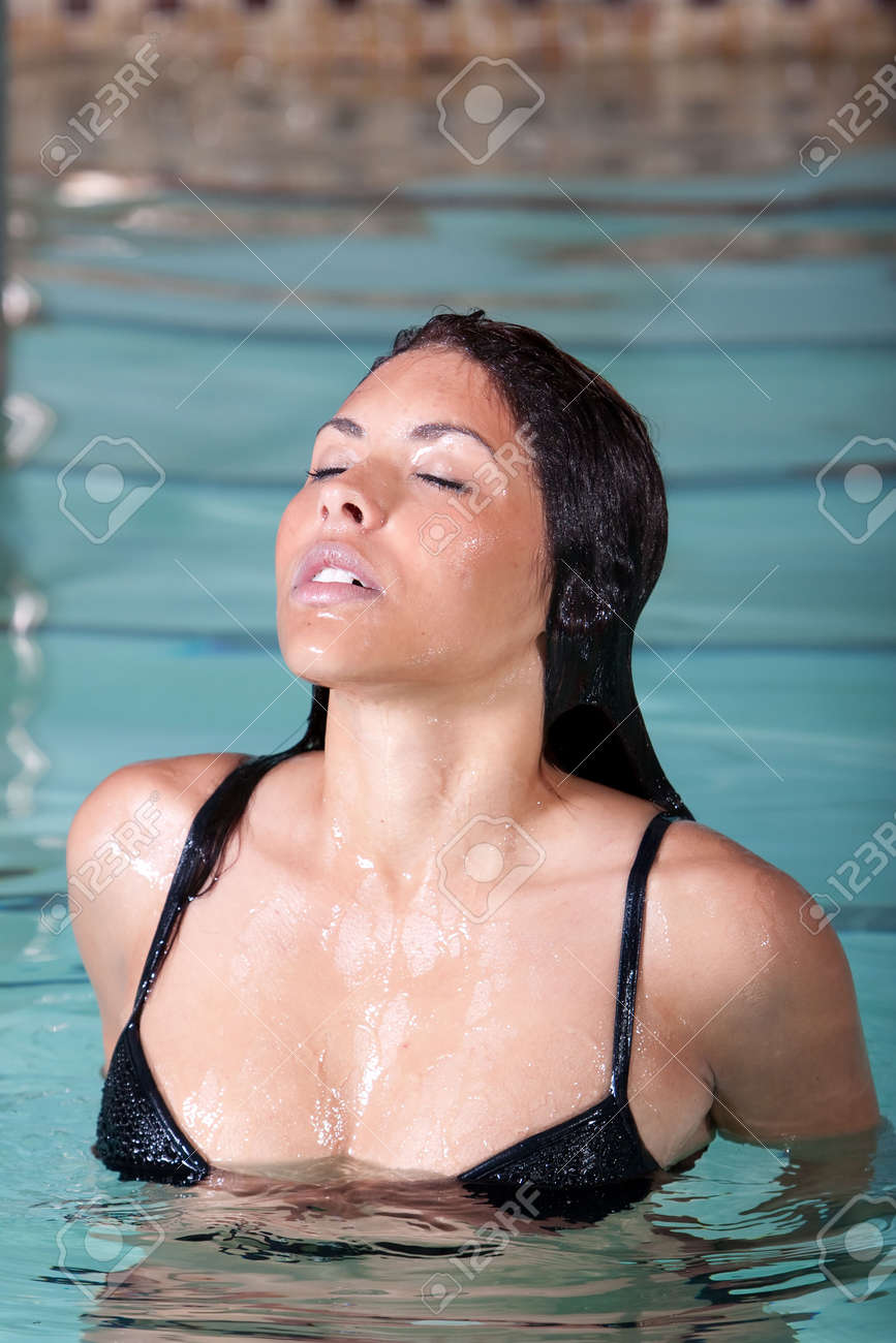 Sexy brunette woman swimming in the pool Stock Photo - 5486332