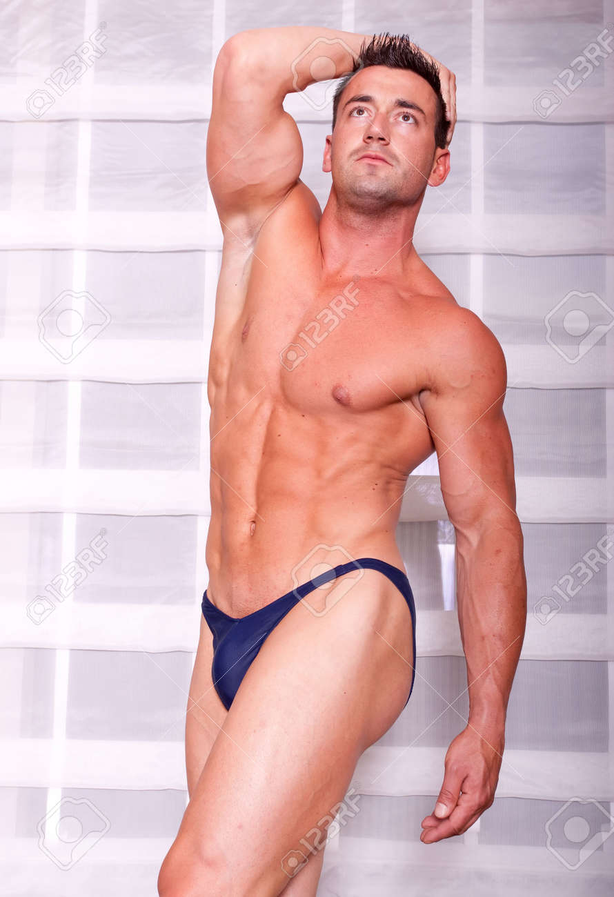 Muscular Body Builder Showing His Muscles Stock Photo Picture And