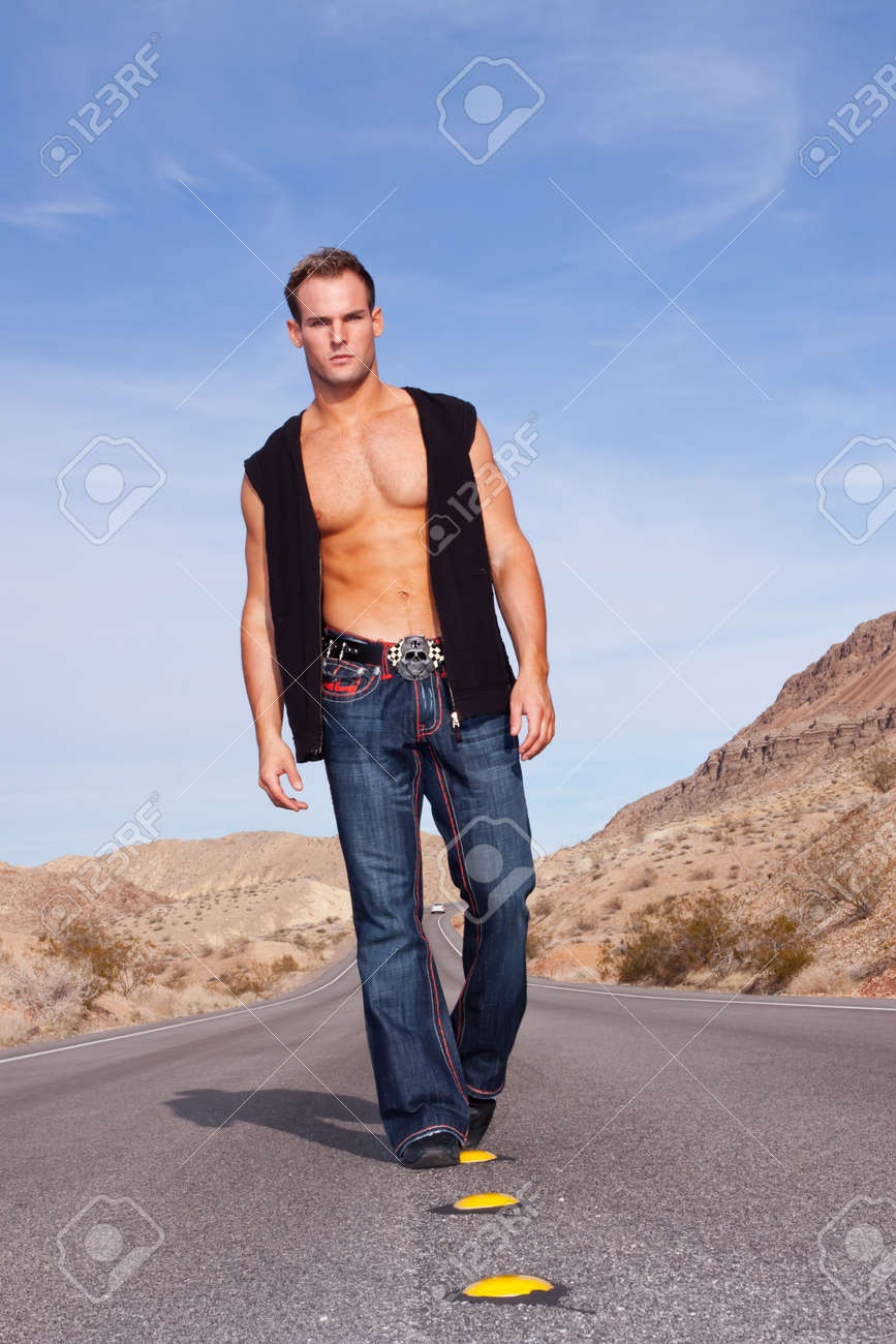 Sexy muscular man standing on road Stock Photo - 6727113