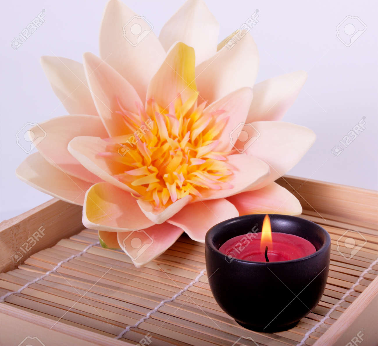 Spa candle and beautiful lotus flower for aromatherapy meditation spa candle and beautiful lotus flower for aromatherapy meditation stock photo 9002694 izmirmasajfo Gallery