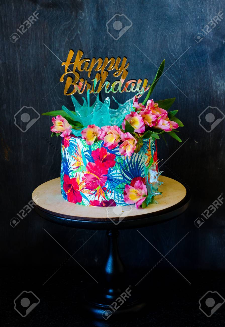 Tropical Birthday Cake On A Cakestand With A Topper Stock Photo ...