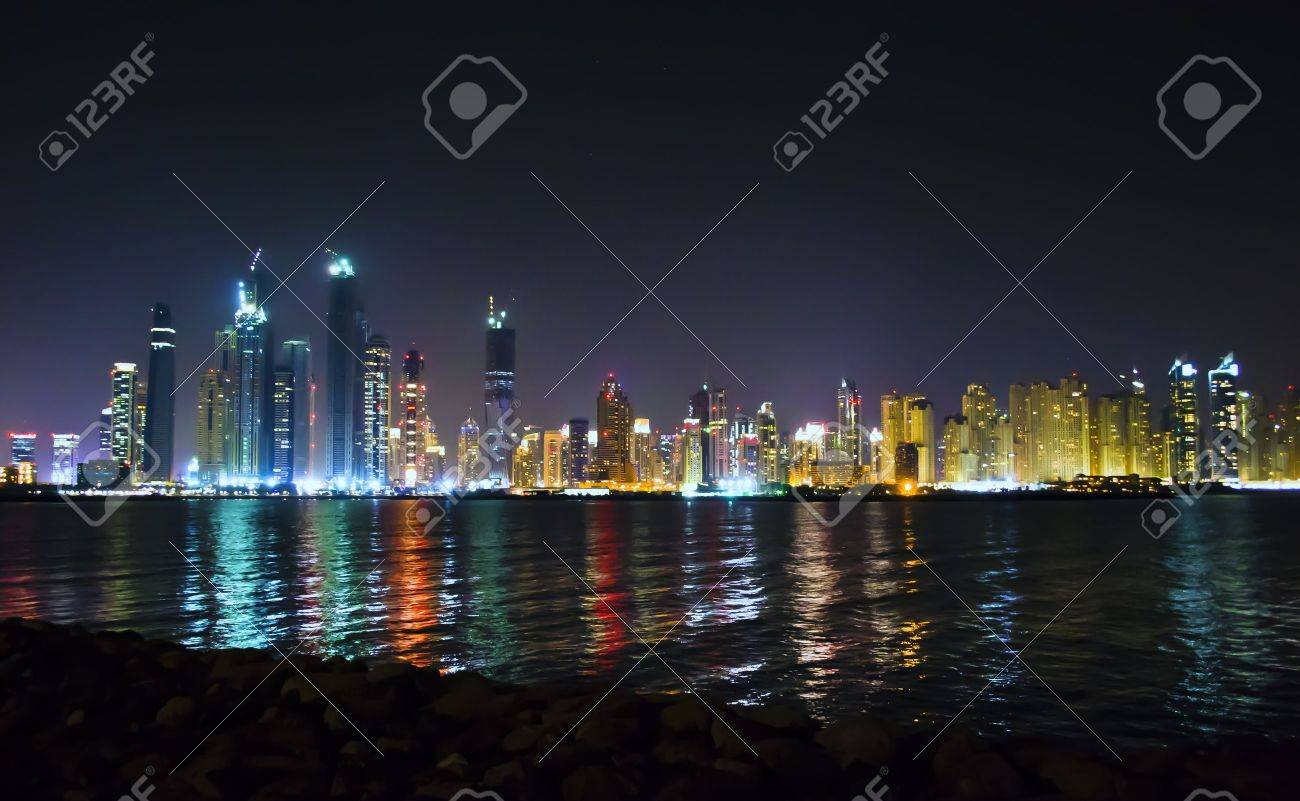 Night Scene on the lighted skyscrapers of Dubai reflected in the water of Persian Gulf Stock Photo - 8908816