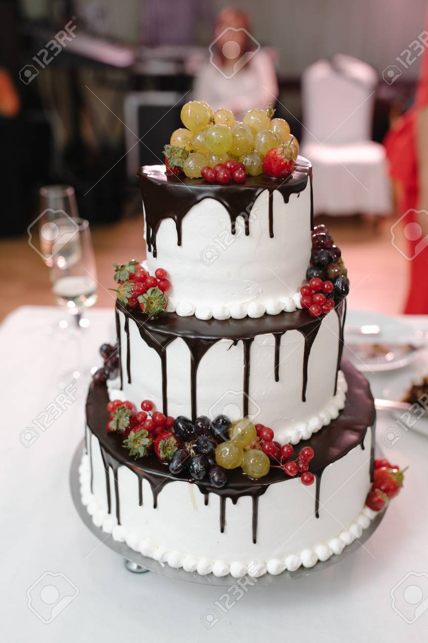 Vertical Shot Of A Black And White Wedding Cake With Fresh