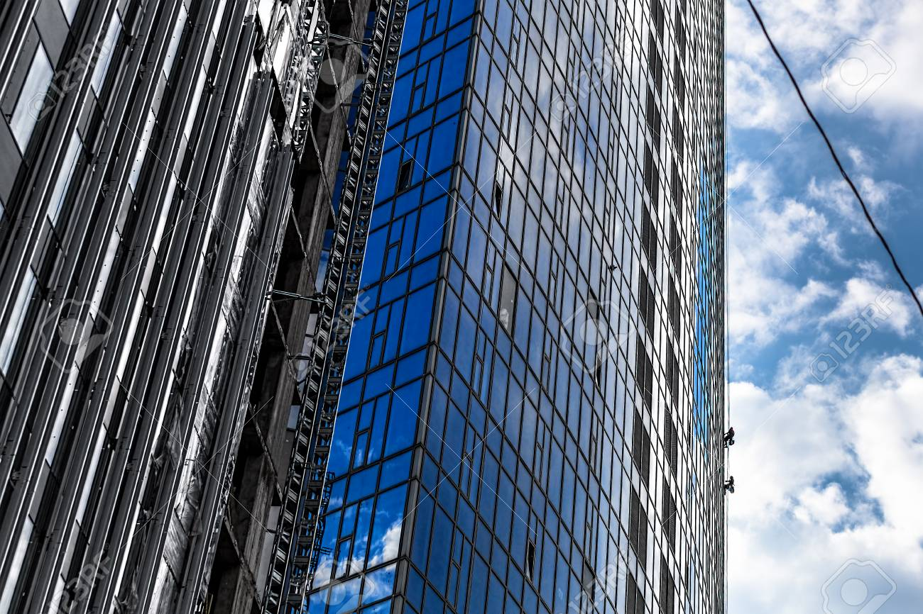 Builders Of The Tallest Building In Kiev On High Altitude Works Stock Photo