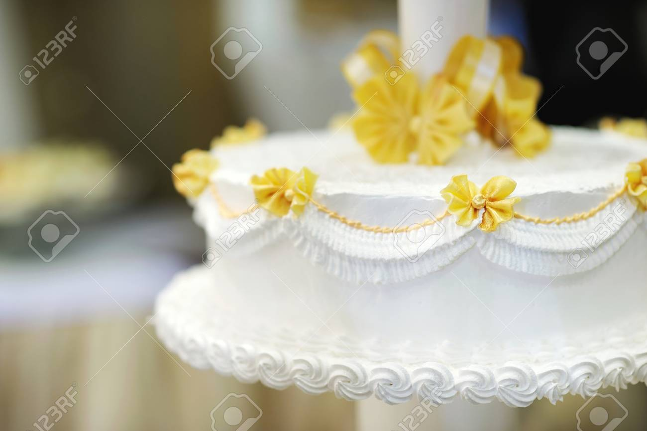 Delicious White And Yellow Wedding Cake Stock Photo, Picture And ...