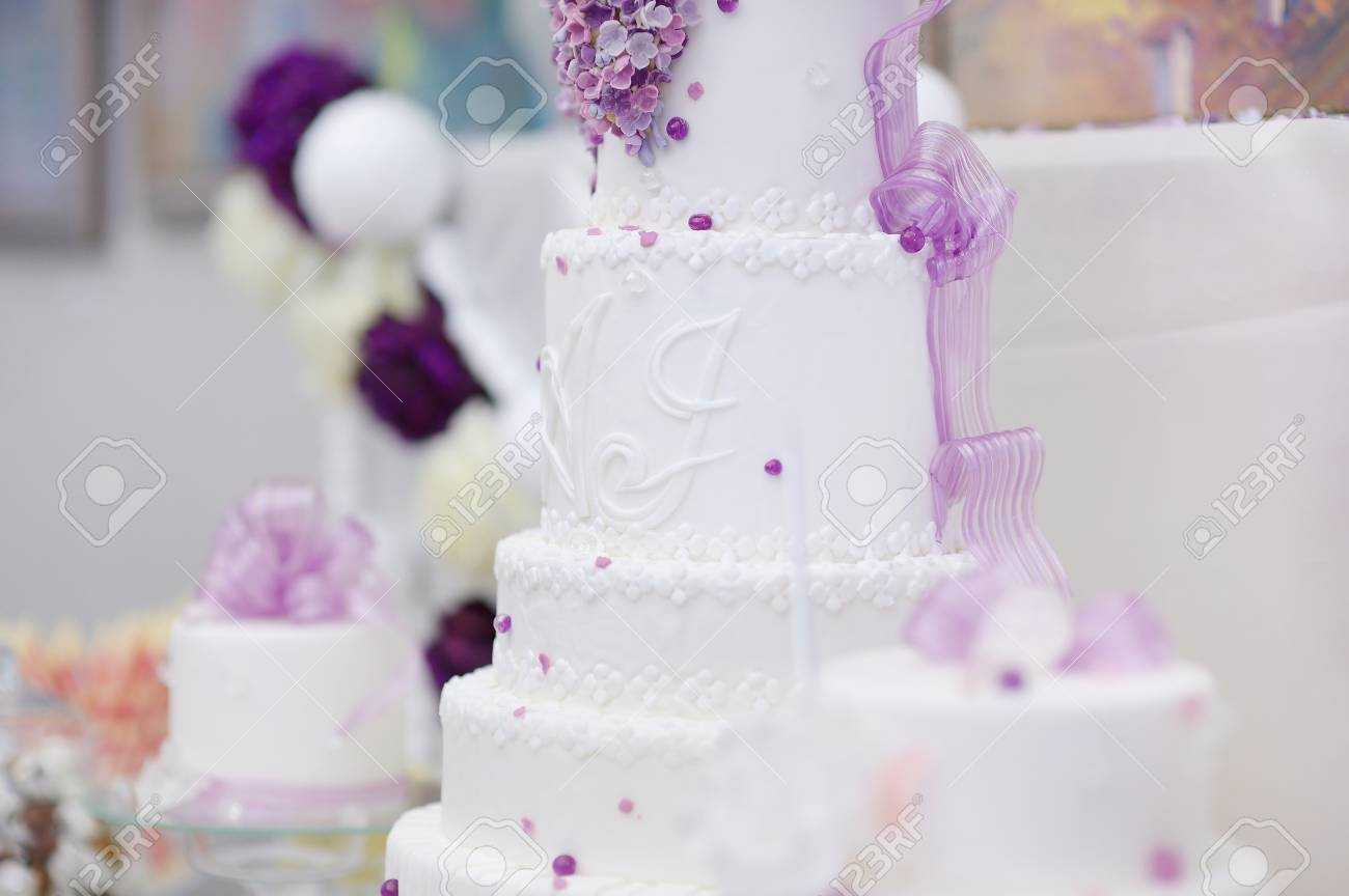 White Wedding Cake Decorated With Sugar Purple Flowers Stock Photo ...
