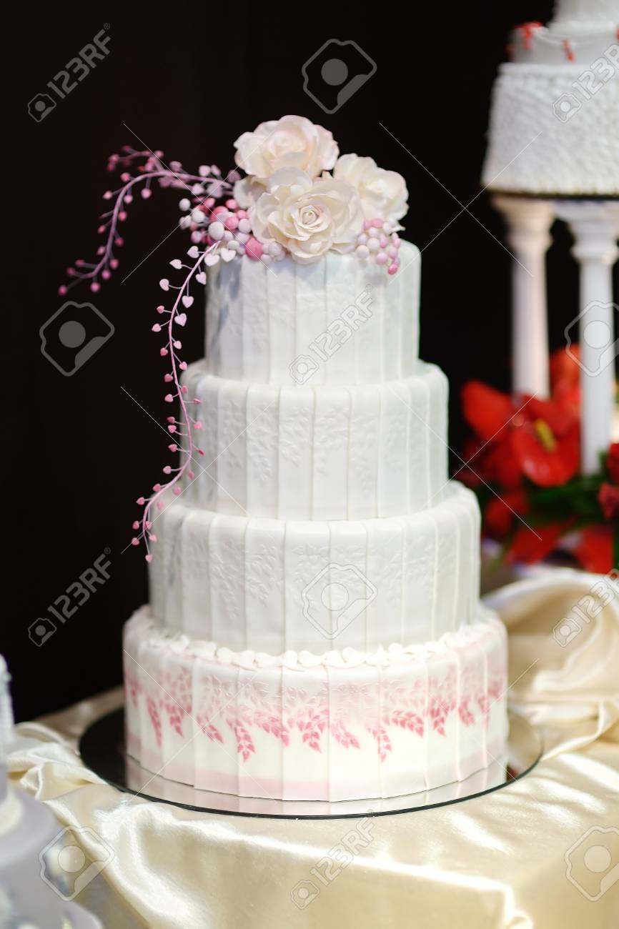 White Wedding Cake Decorated With Sugar Pink Flowers Stock Photo ...