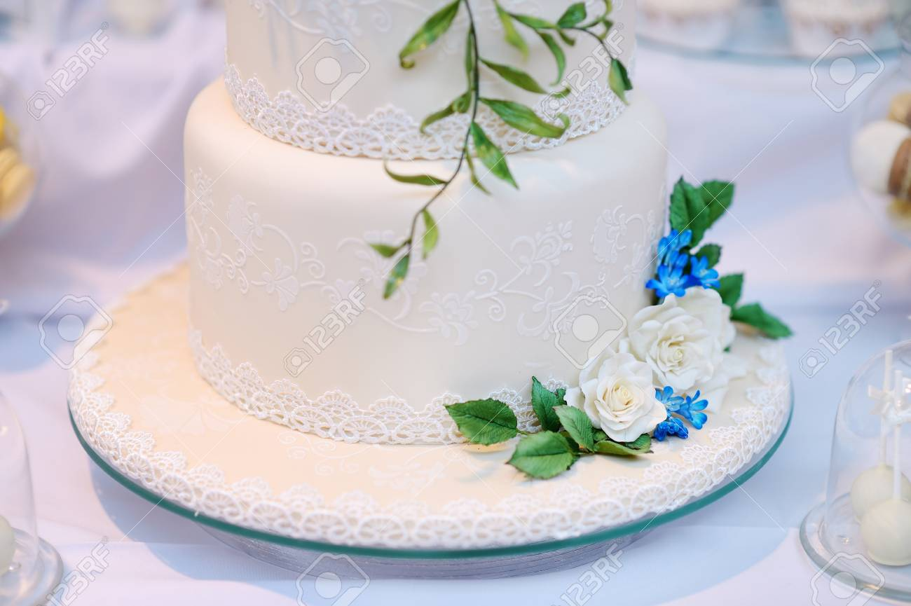 White Wedding Cake Decorated With Sugar Flowers Stock Photo, Picture ...