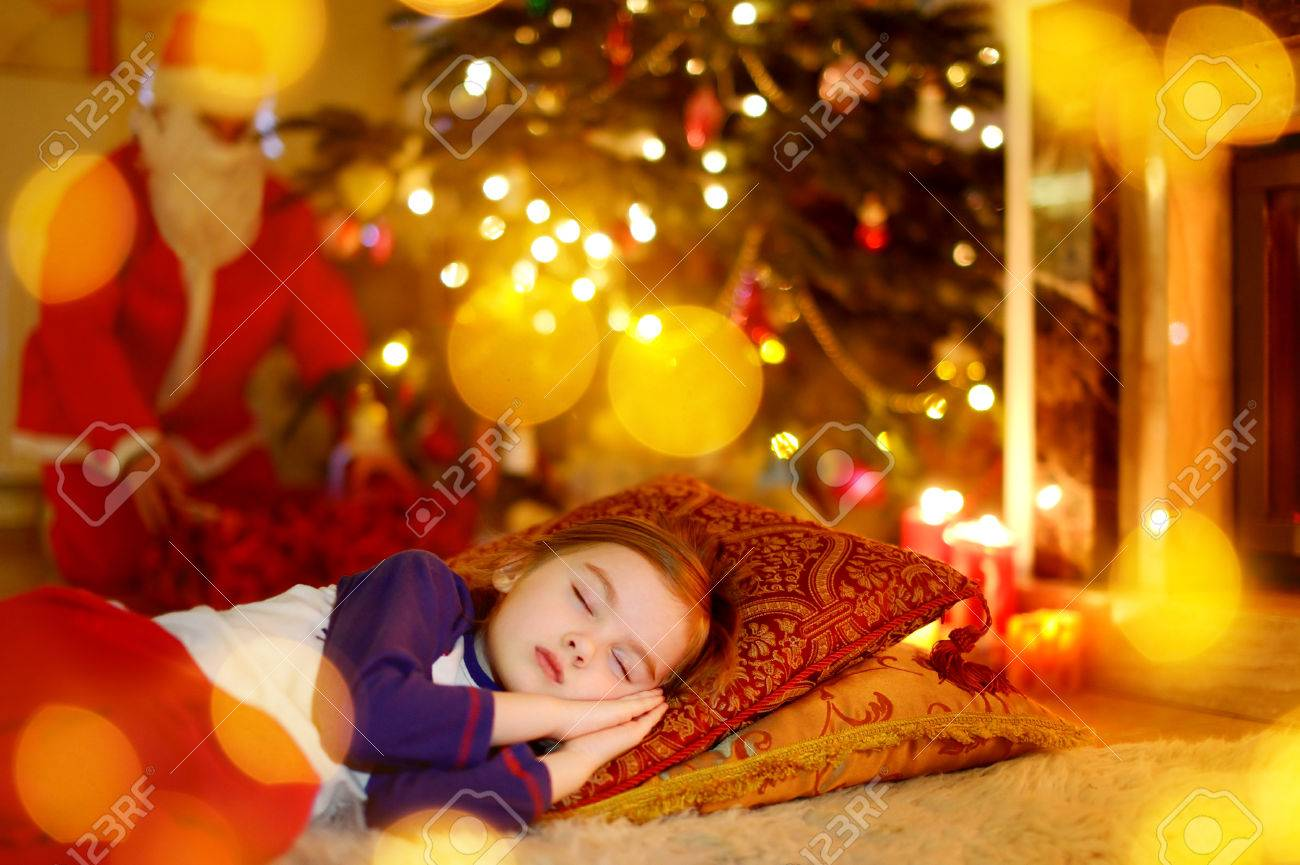 Adorable Little Girl Sleeping Under The Christmas Tree By A ...
