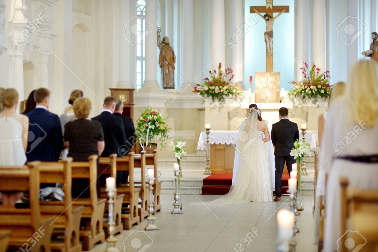 Bride and groom at the church during a wedding ceremony - 41259822