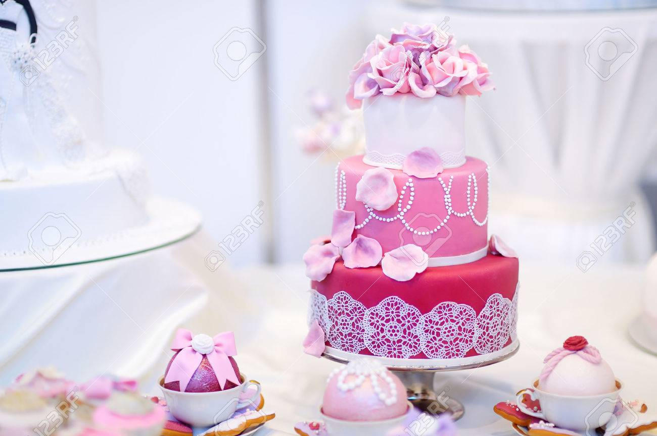 White Wedding Cake Decorated With Pink Sugar Flowers Stock Photo ...