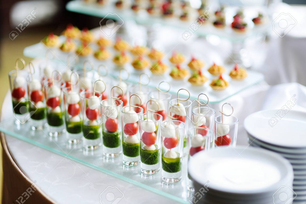 plates with assorted finger food snacks on an event party or stock