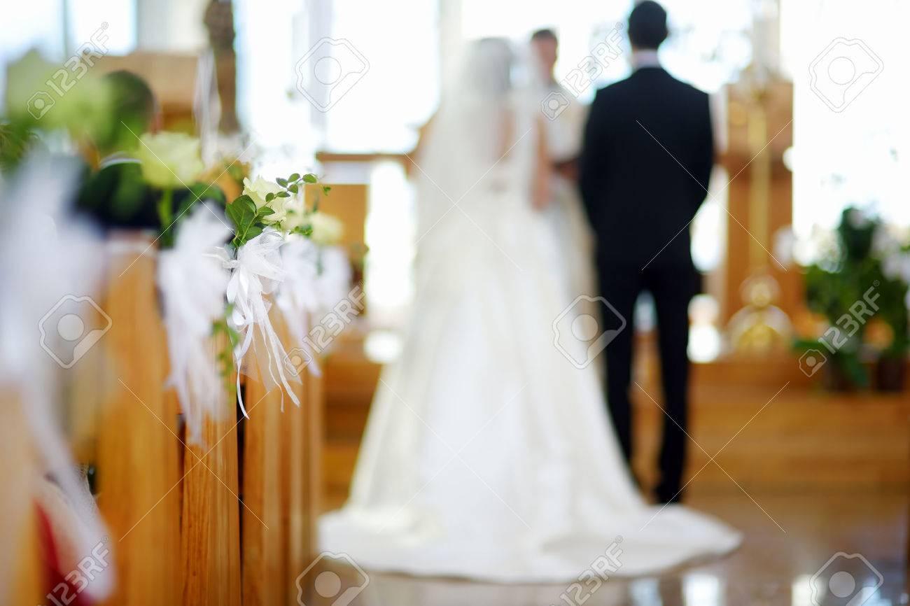 Catholic wedding stock photos royalty free catholic wedding beautiful flower wedding decoration in a church during catholic wedding ceremony stock photo junglespirit Choice Image