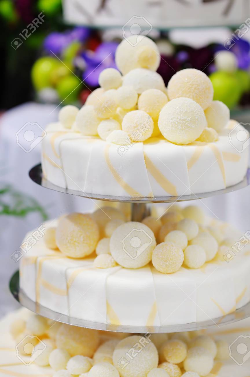 Fancy Delicious White And Yellow Wedding Cake Stock Photo, Picture ...