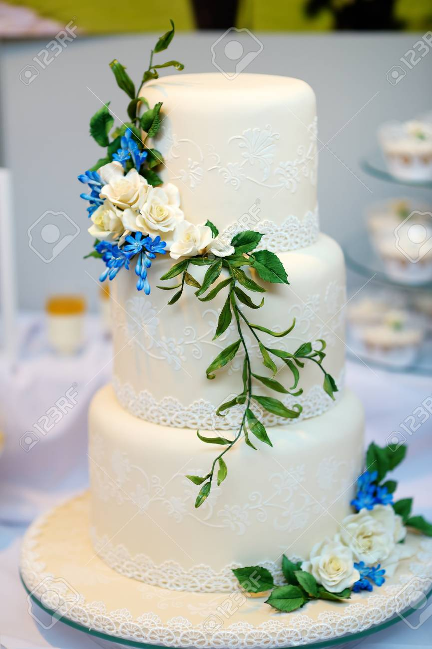 White wedding cake decorated with blue sugar flowers stock photo stock photo white wedding cake decorated with blue sugar flowers izmirmasajfo