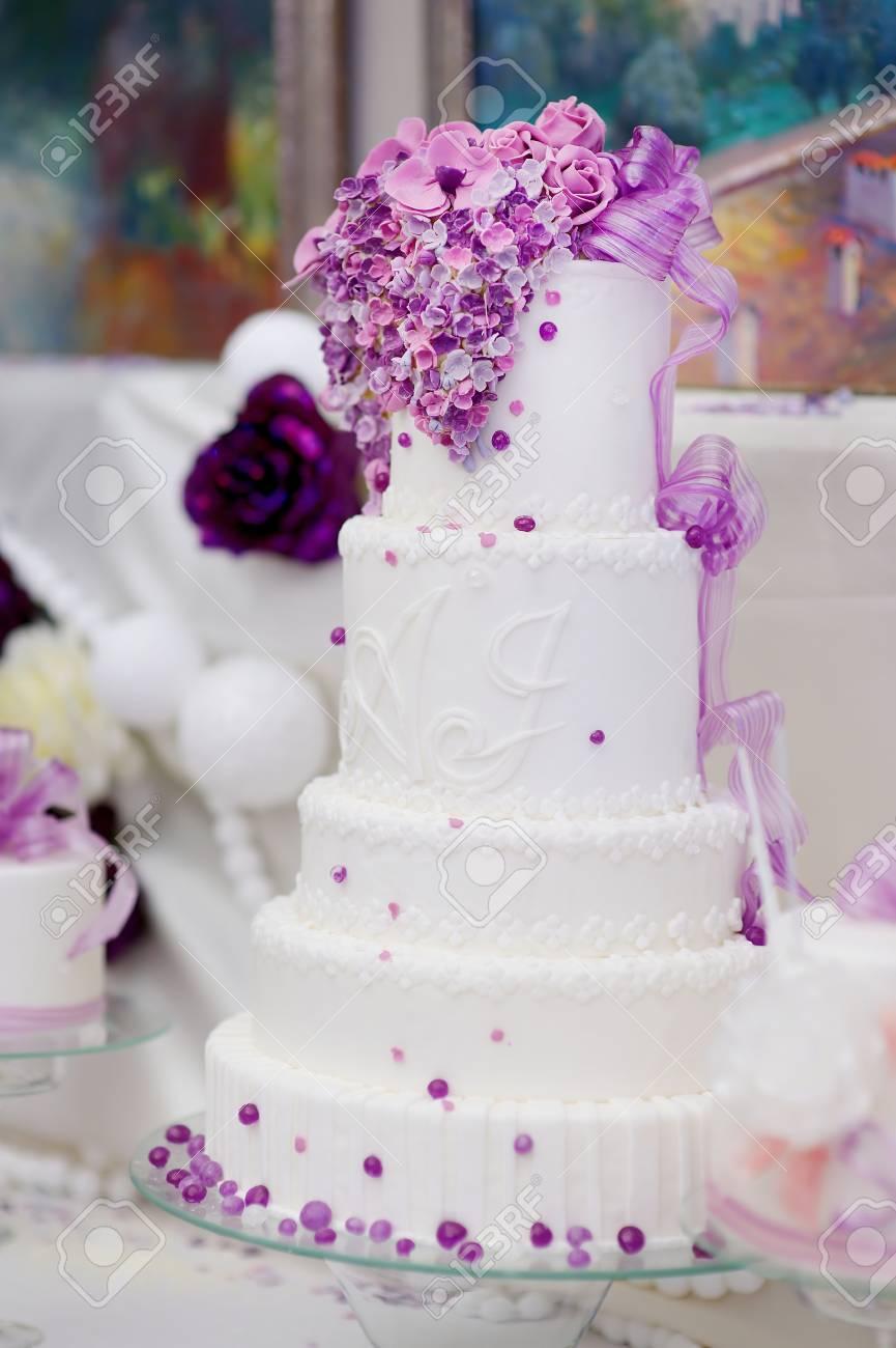 White Wedding Cake Decorated With Sugar Purple Bubbles Stock Photo ...