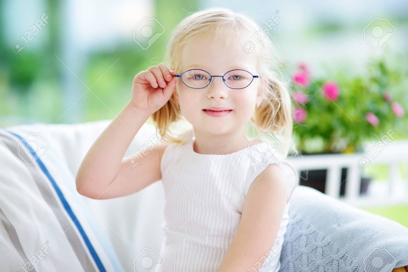 74a20cdfa97 Portrait Of Beautiful Little Girl Wearing Glasses At Home. Vision ...