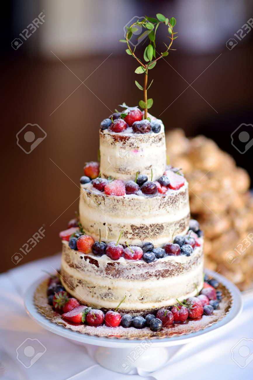 Delicious chocolate wedding cake decorated with variuos fruits..